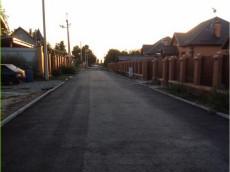 Асфальтирование дороги в поселке
